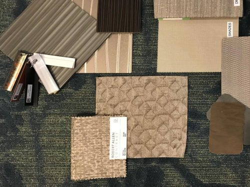 Picture of flooring examples and a swatch book