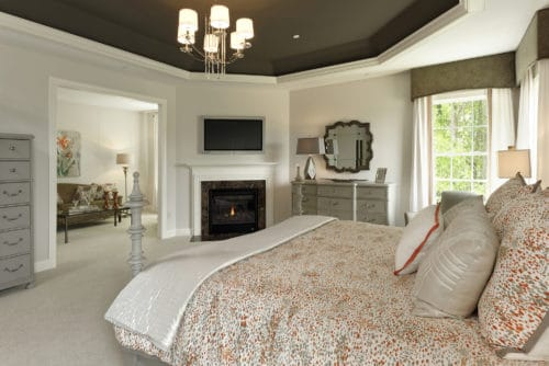 Classic and elegant owners bedroom pale gray case goods