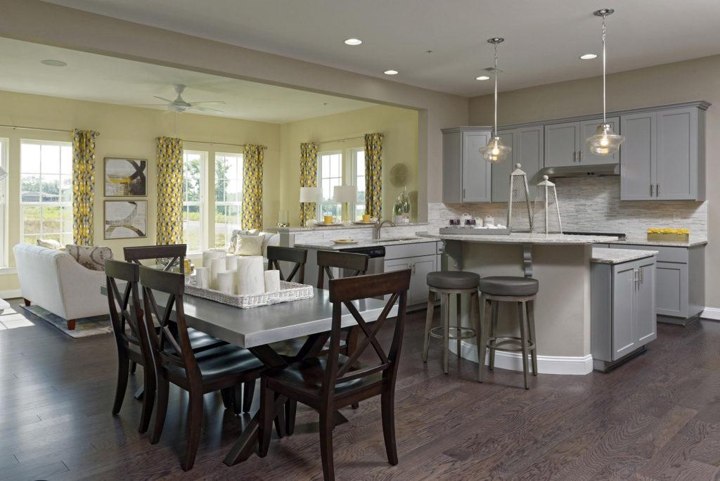 Modern gray kitchen, zinc tabletop and stacked stone backsplash add polish & style