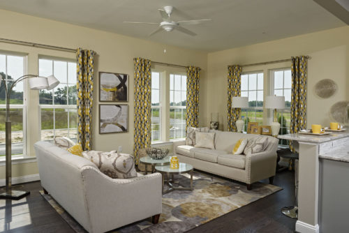 Sunny and bright, balanced and bold a sunroom that beckons visitors to take a seat and stay awhile