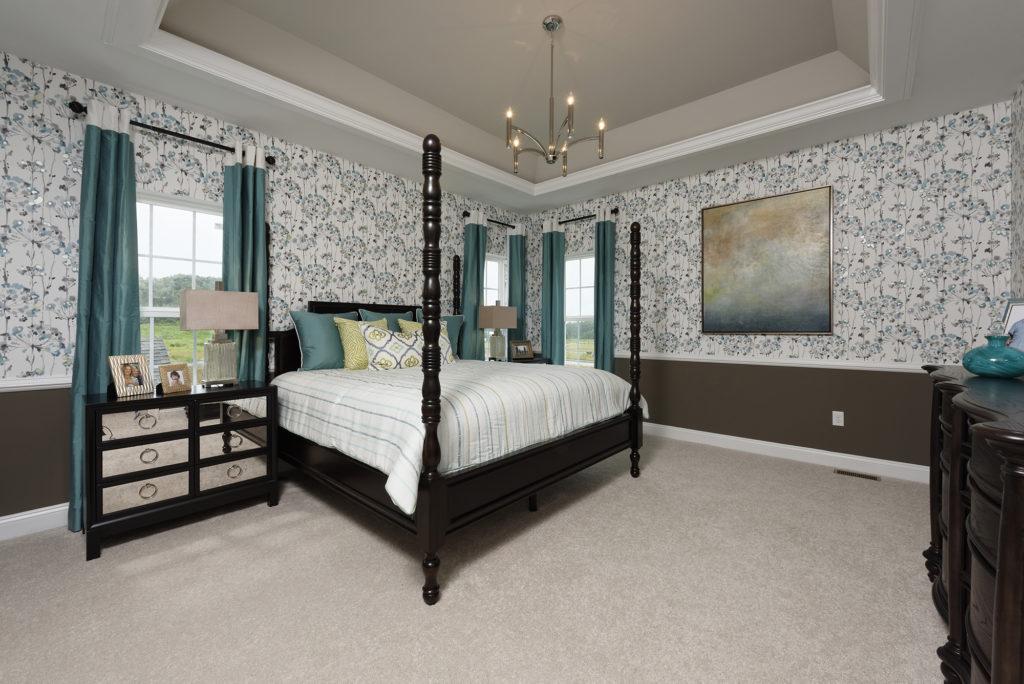 Designer wallpaper & custom bedding adds drama and elegance to this master suite