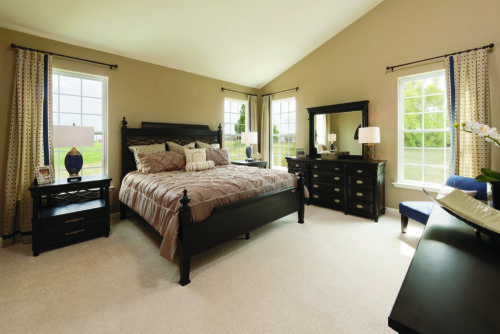 Master Bedroom in tan and rich dark woods