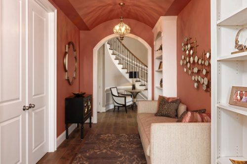 Gallery in rich persimmon color with accents of gold
