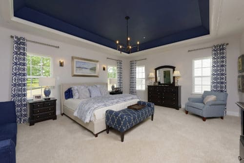 Beautiful in blue. Pattern, texture and bold color enhance the spaciousness of this Owner's Suite